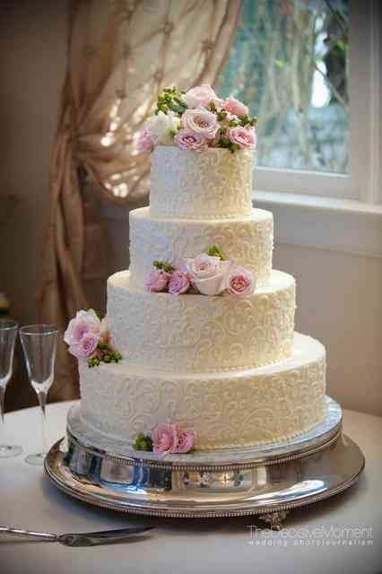 wedding cake with roses and swirls