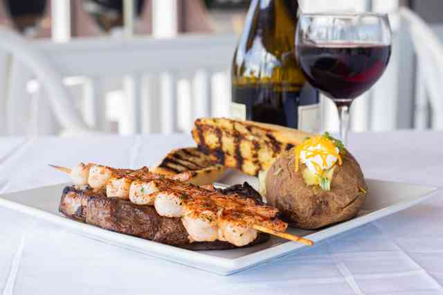 steak and shrimp with wine