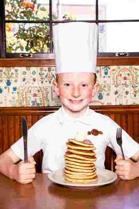 kid chef with pancakes