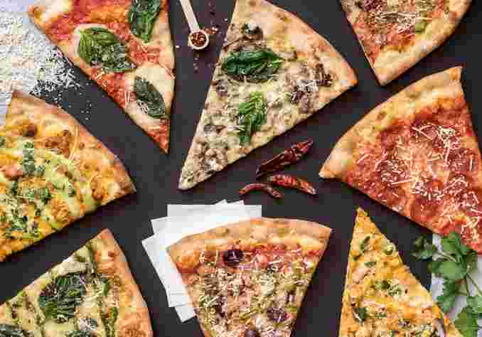 multiple pizza slices against dark background