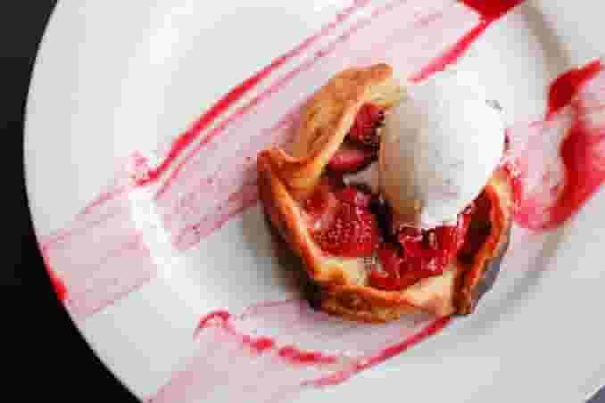 strawberry tart dessert with vanilla ice cream