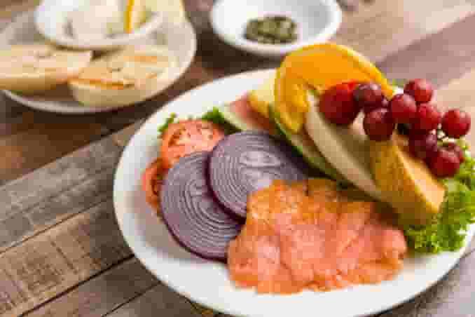 Lox Bagel, Cream Cheese, Onion, Tomato & Fresh Fruit