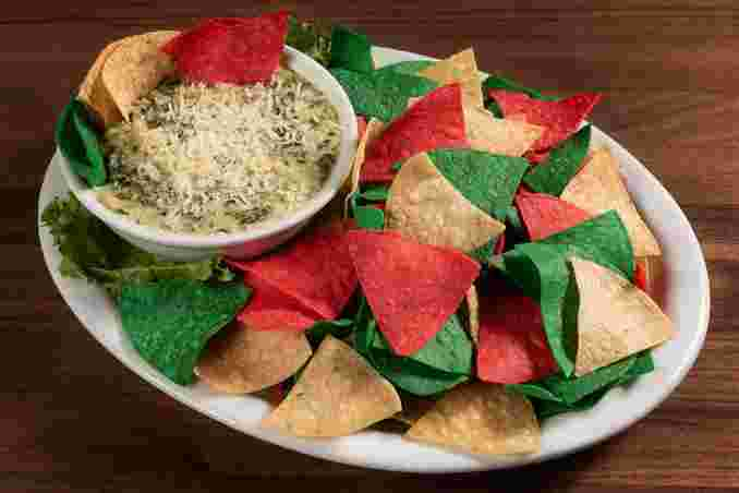 Spinach Artichoke Dip served with Tri-Colored Tortilla Strips