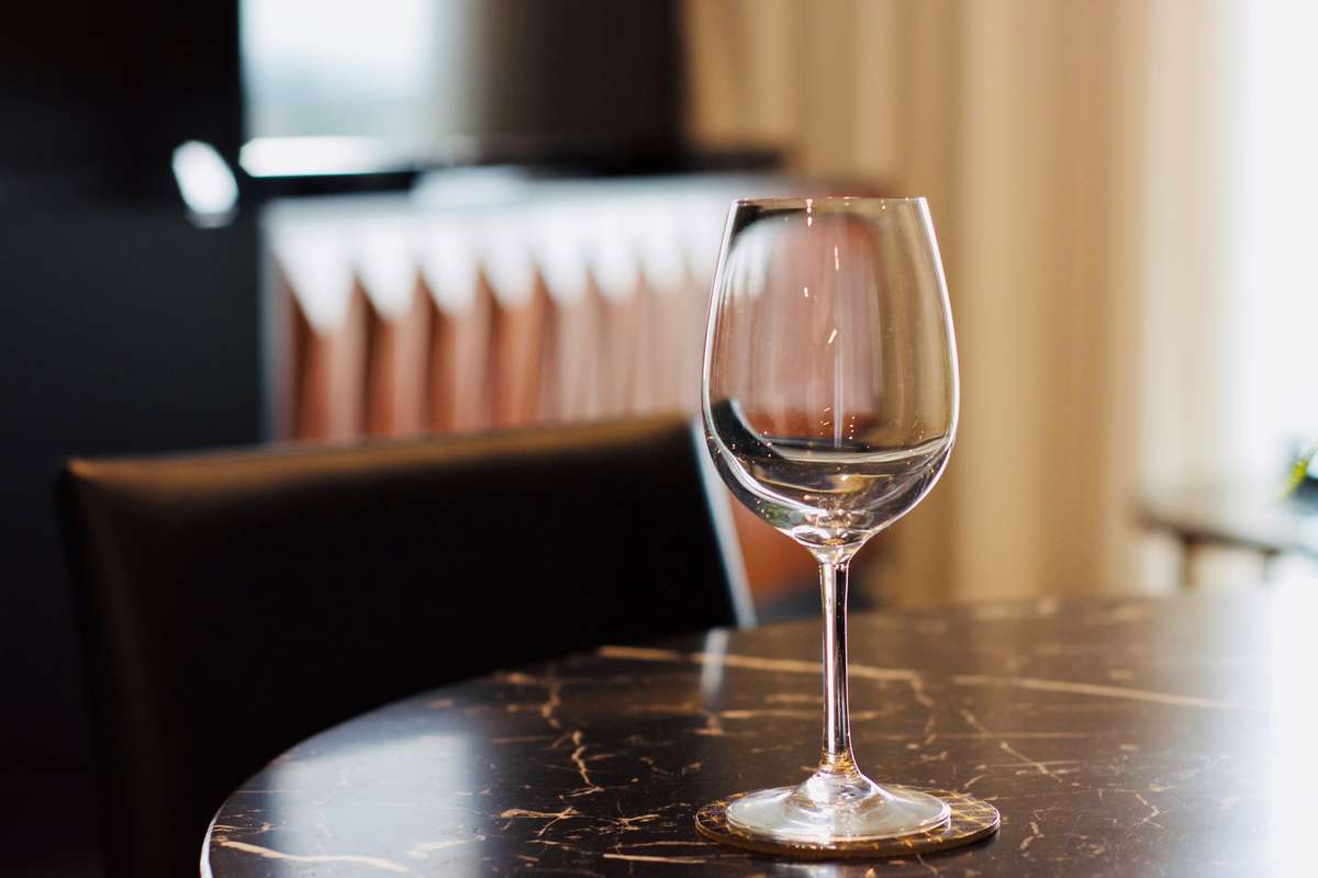 wine glass on marble table stock image