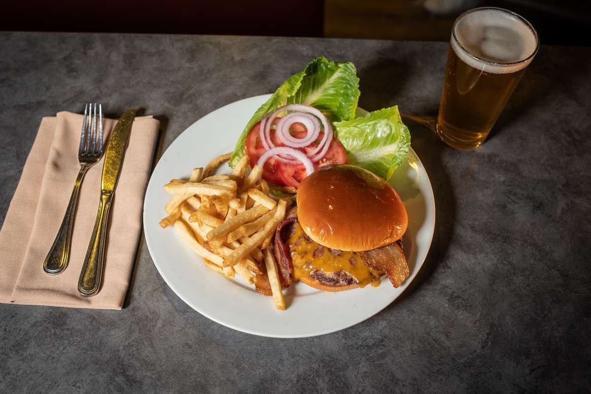 Burger with fries and salad fixings