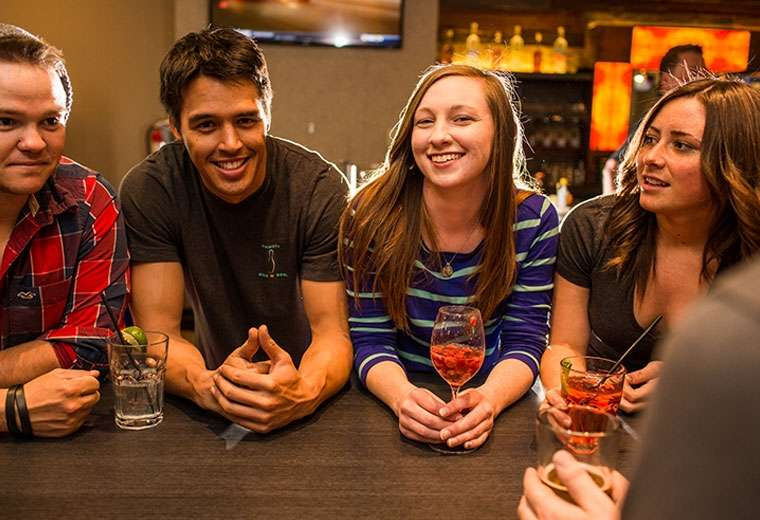 Friends enjoying conversation and drinks