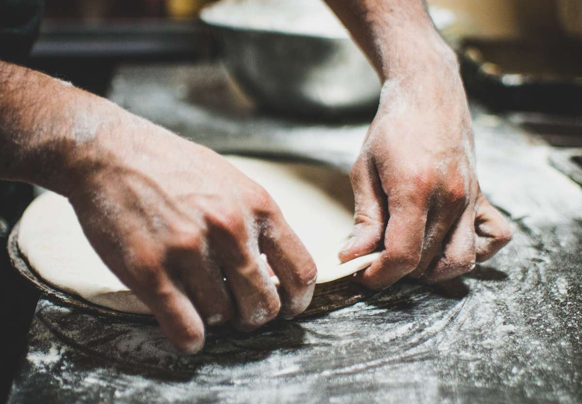 hands working with dough