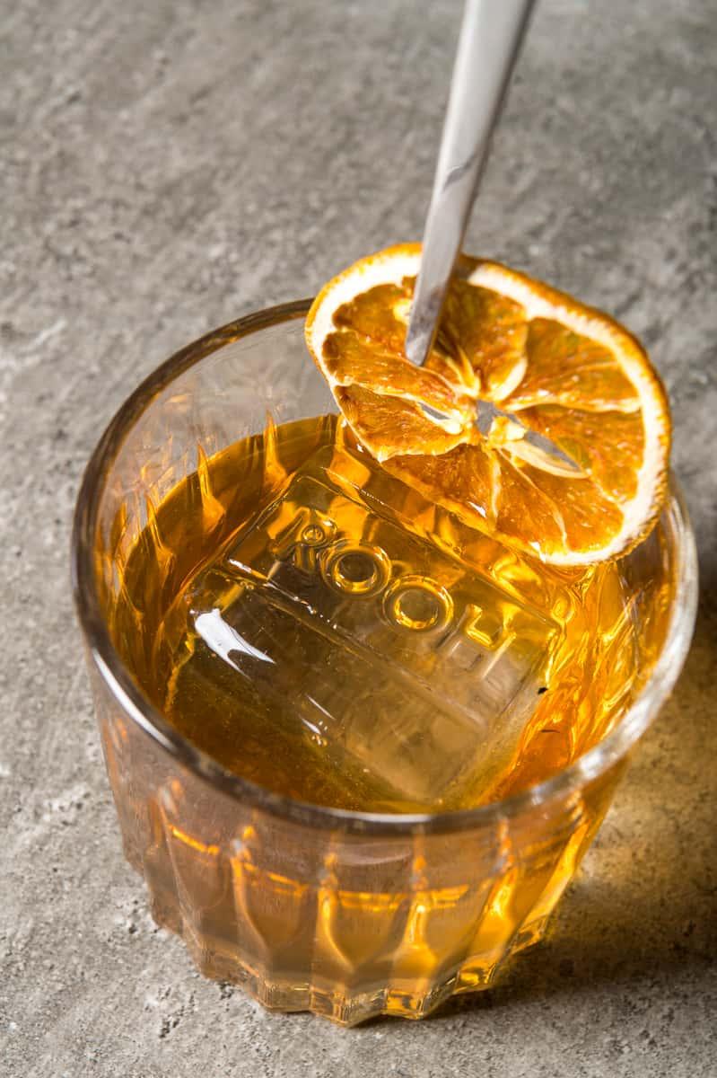 Adding orange to cocktail