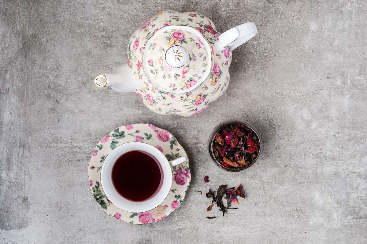 teapot with cup of tea