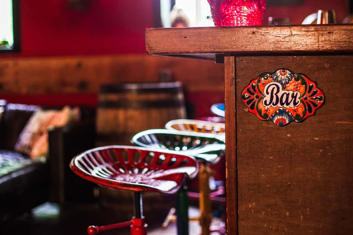 bar stools and bar sign