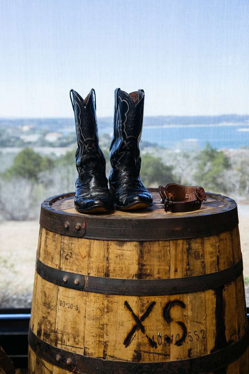 Boots on top of branded barrel