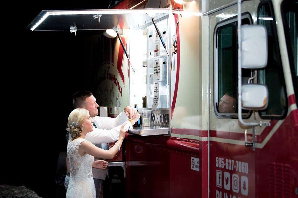 wedding couple ordering from food truck