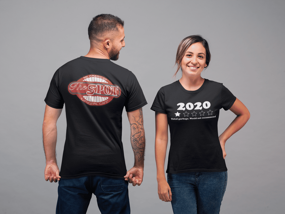 """Men and womens black t-shirt with The Spot Cafe logo on the back and on the front 2020 with a 1 star rating with the a comment that says """"Total Garbage. Would not recommend."""""""