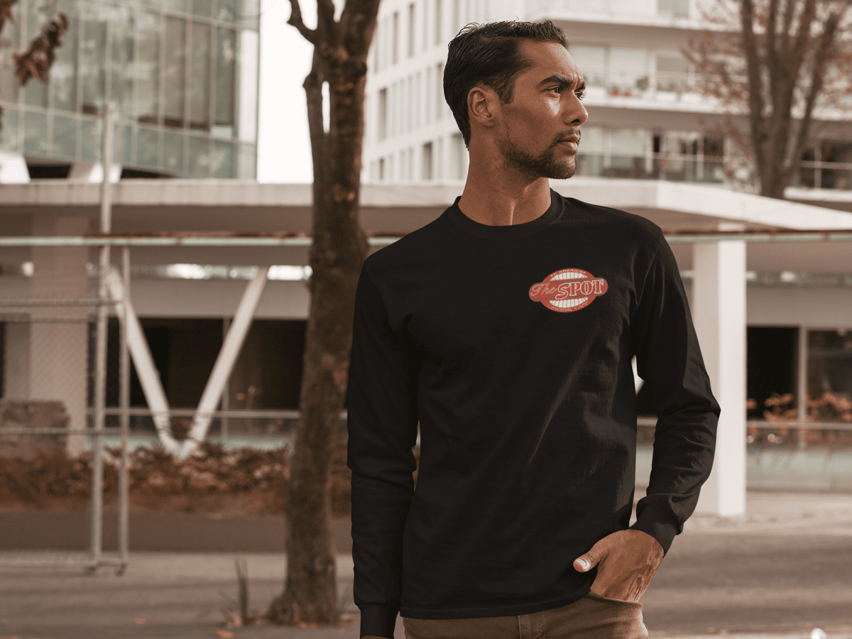 The Spot Cafe long sleeve black shirt with a small spot cafe logo on the front and large on the back