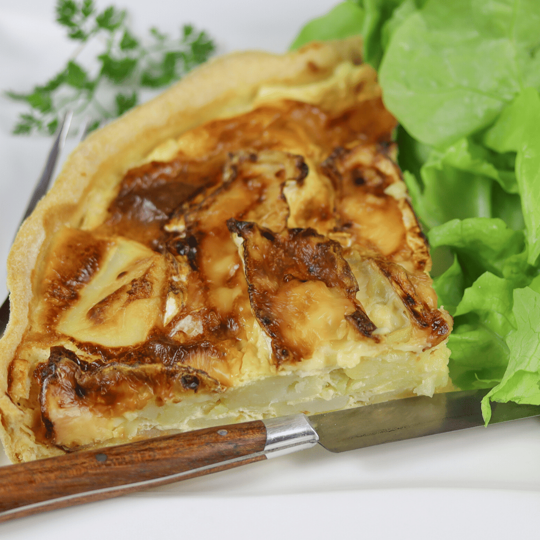 Quiche with mixed greens