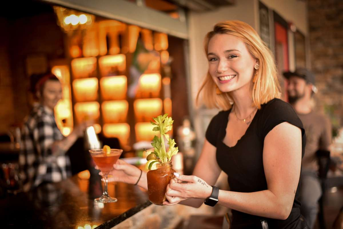 waitress holding bloody mary