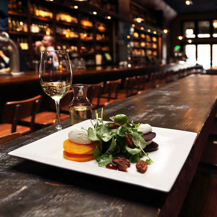 Whiskey street bar with a meal and wine