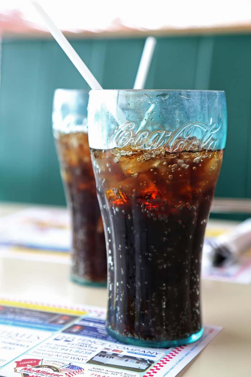 Proudly serving Coca-cola