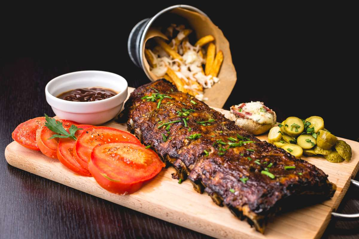 ribs and fries with veggies