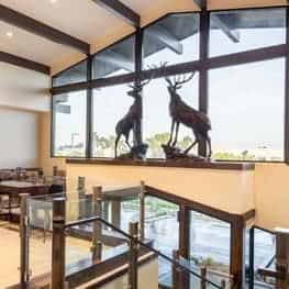 New Santa Ana  Elks building with Elk statues at sunset