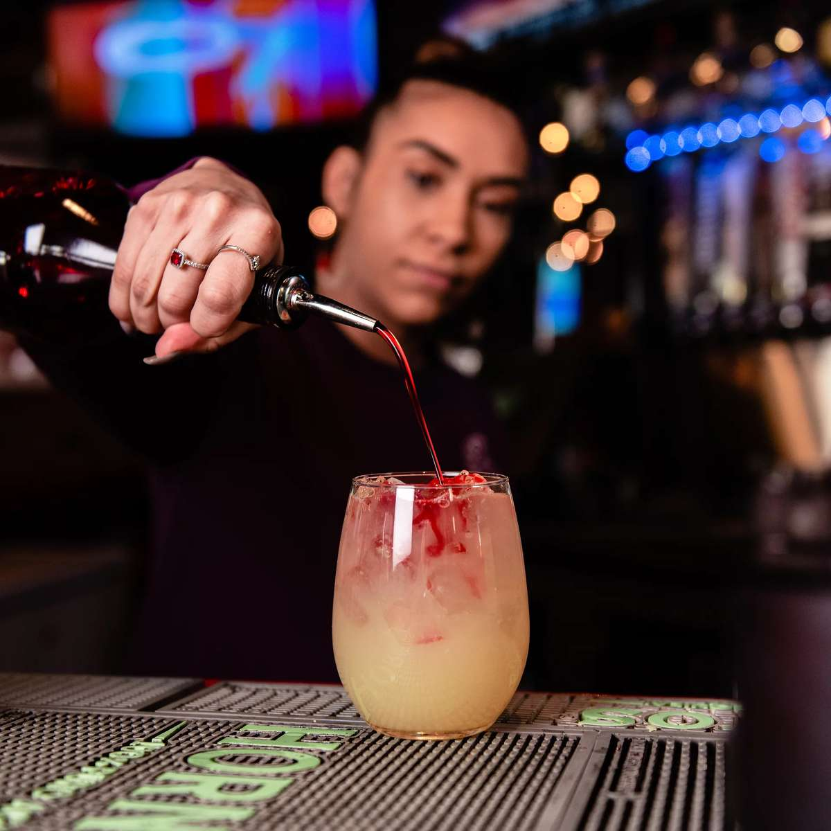 Bartender pouring a mixed drink