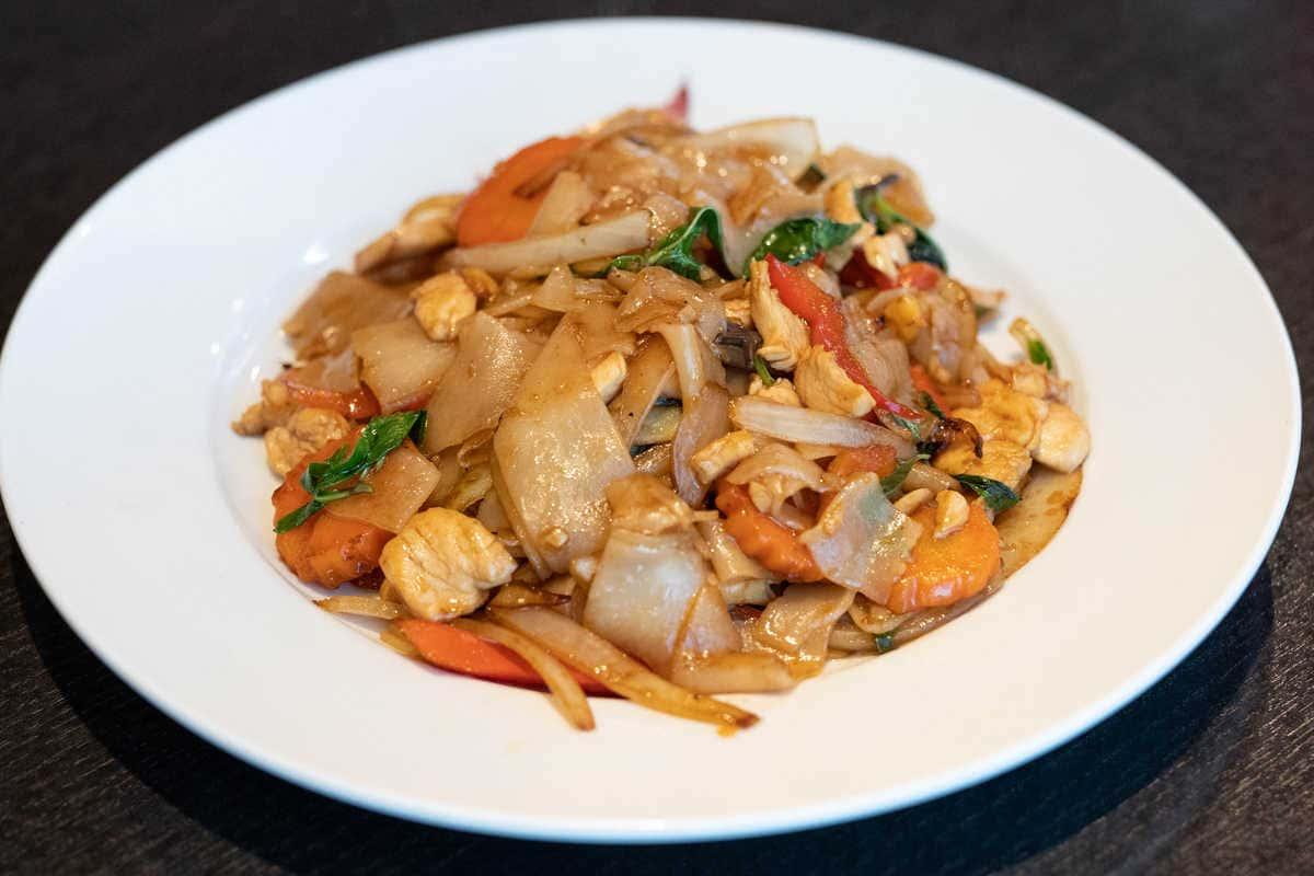 Drunken Noodles Chicken + Thai Iced Tea ($ Save 2.95)