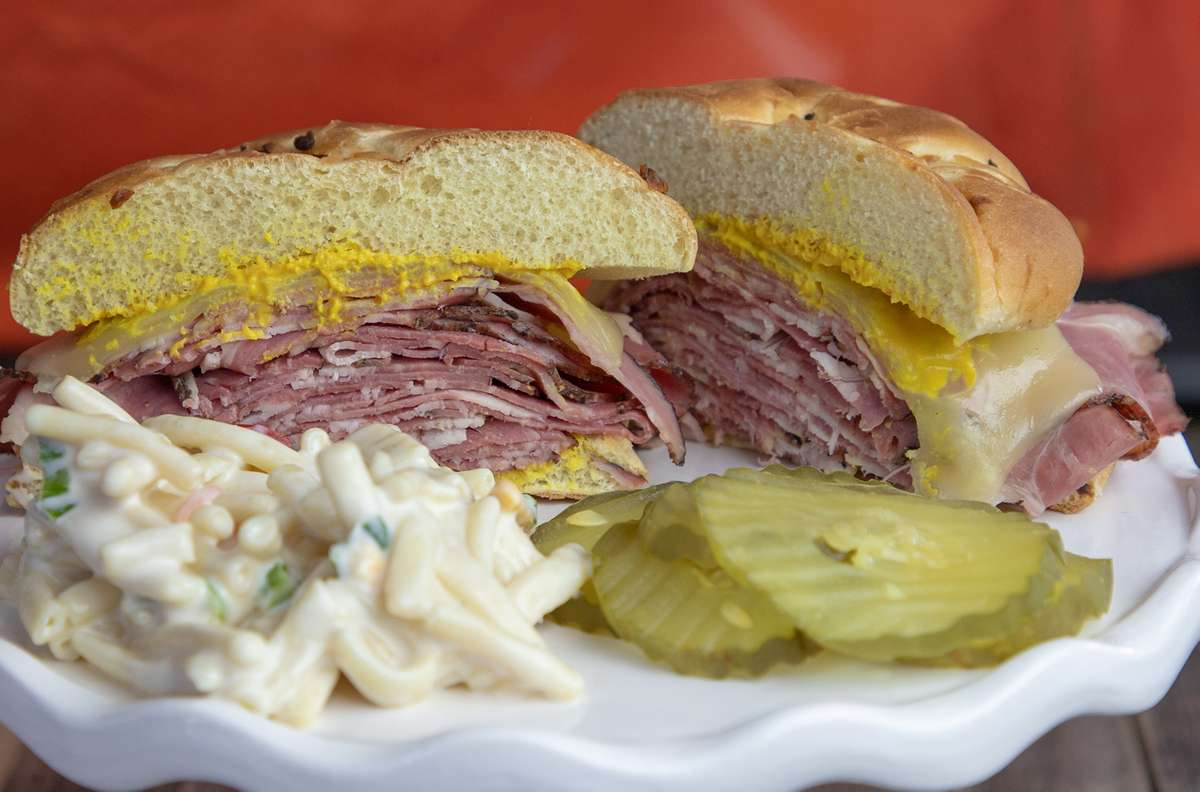 HOT PASTRAMI ON ONION ROLL WITH PICKLES AND SIDE SALAD