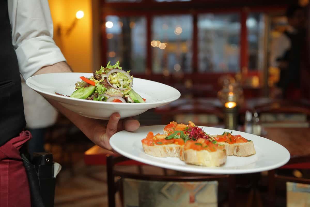 waitress holding plates