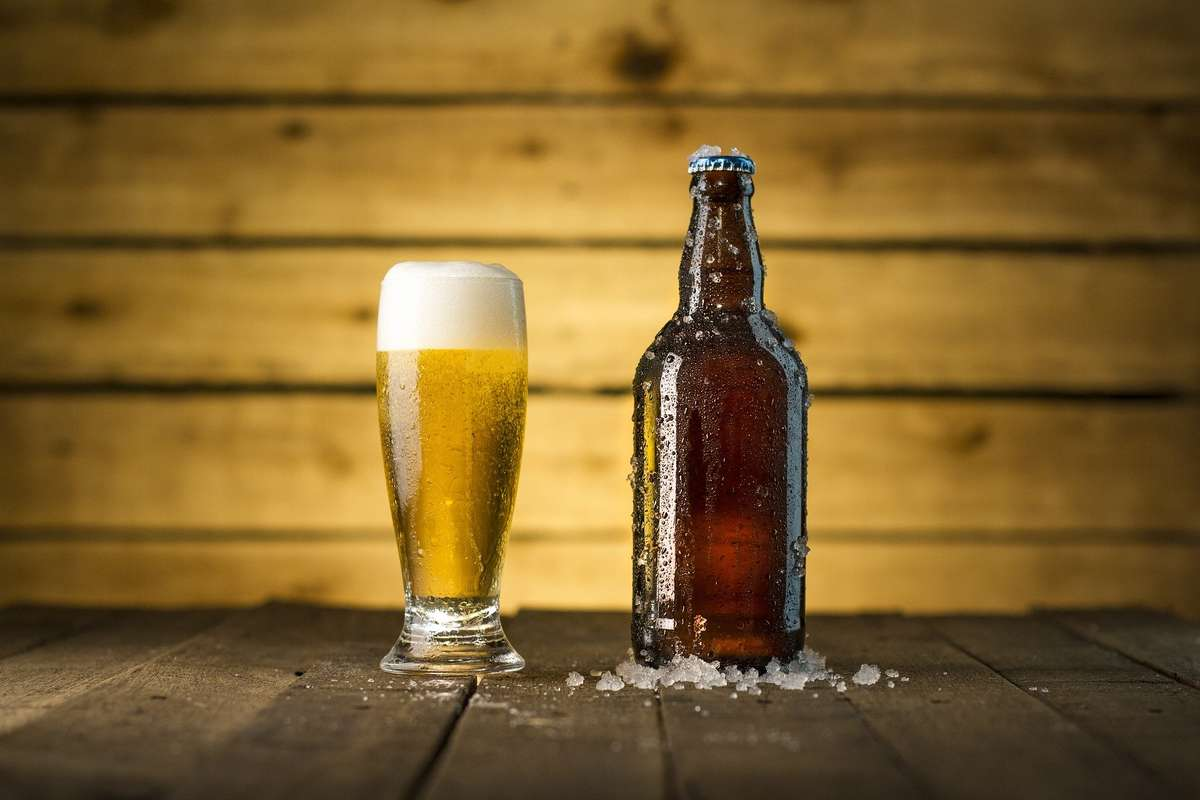 Glass of beer and bottle of beer