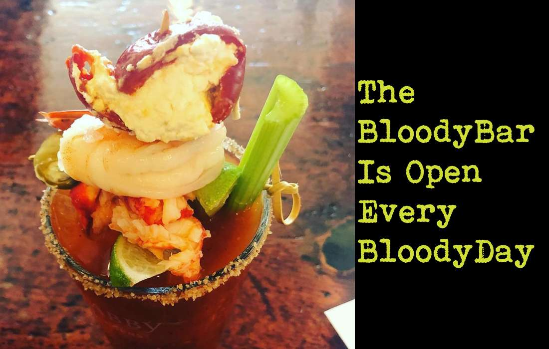 Bloody Mary with shrimp, red pepper, celery lime