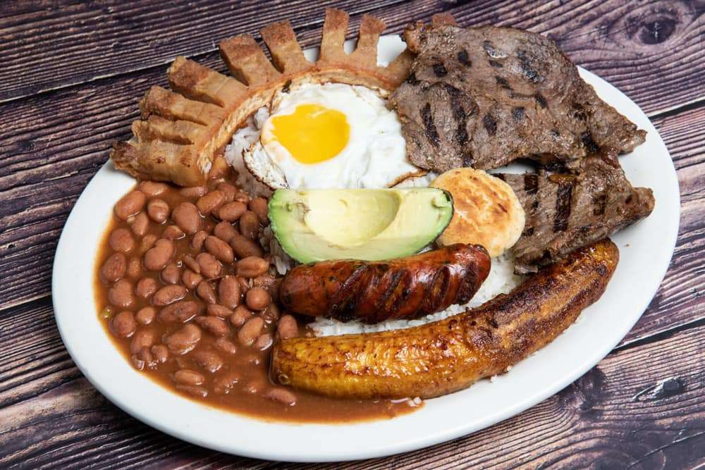 Various meats with beans, eggs and avocado