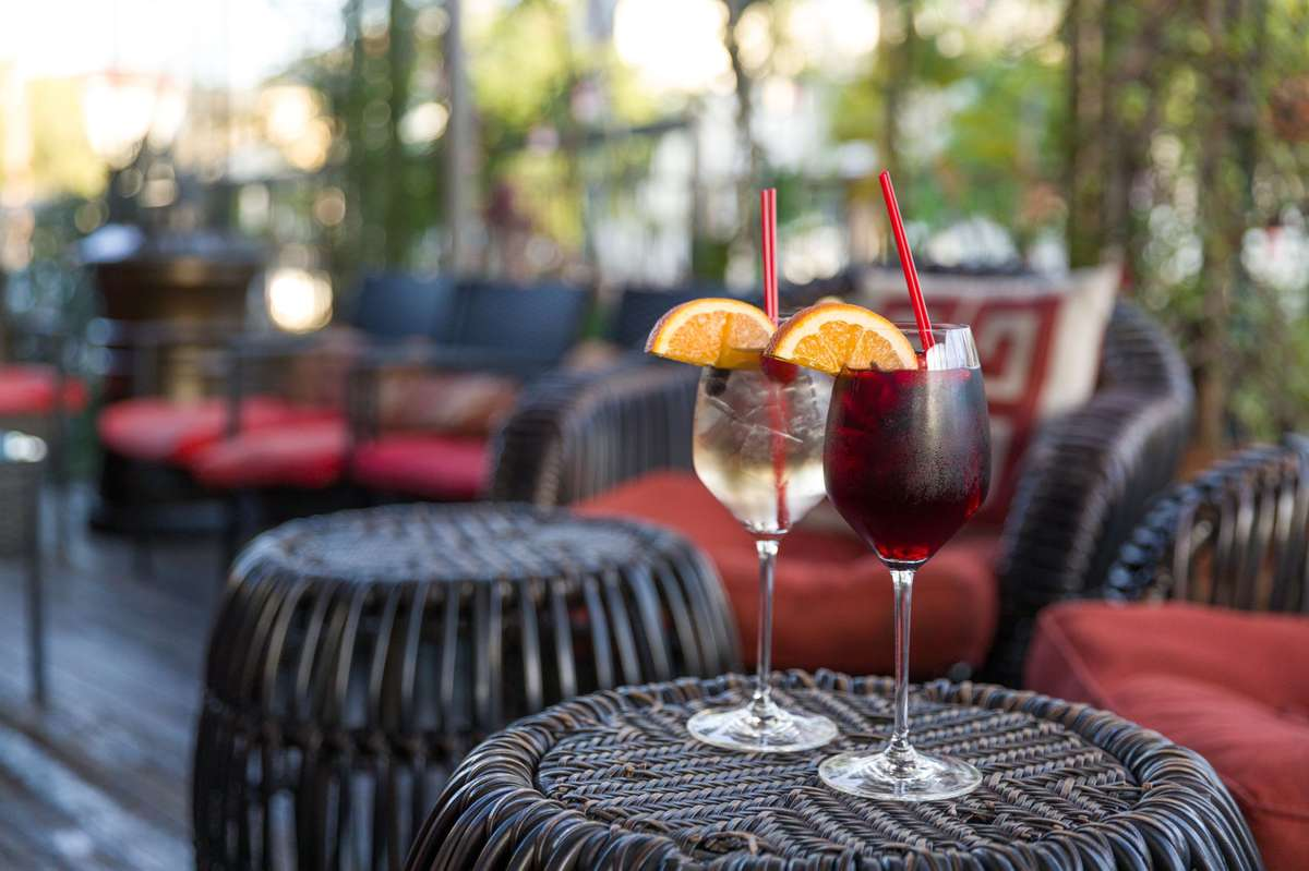 Red and white sangrias on patio table