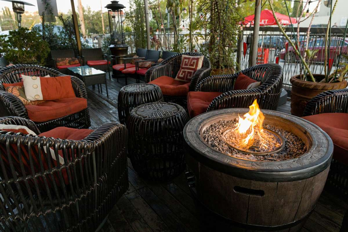 Patio area with tables and fire pit