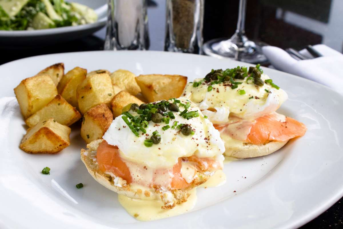 Smoked Salmon Benedict with capers, chives, and hollandaise sauce.