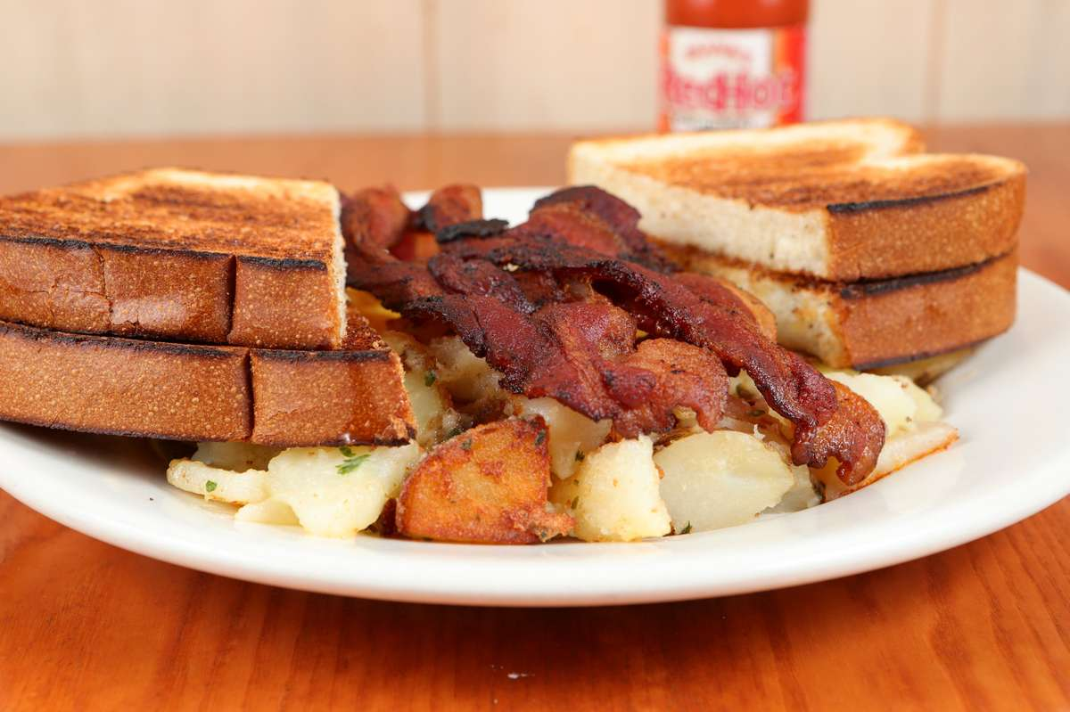 #4 Two Eggs*, Toast, Potato and Meat