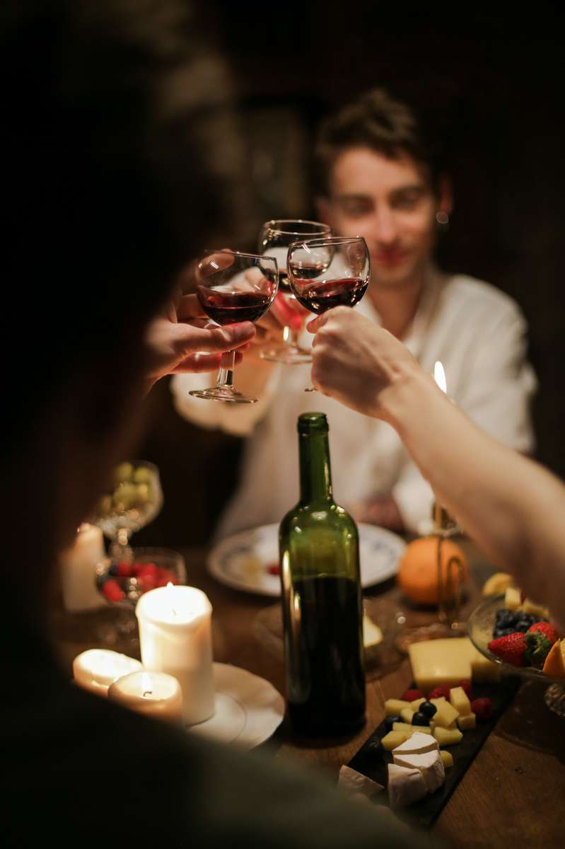 people sharing wine and food
