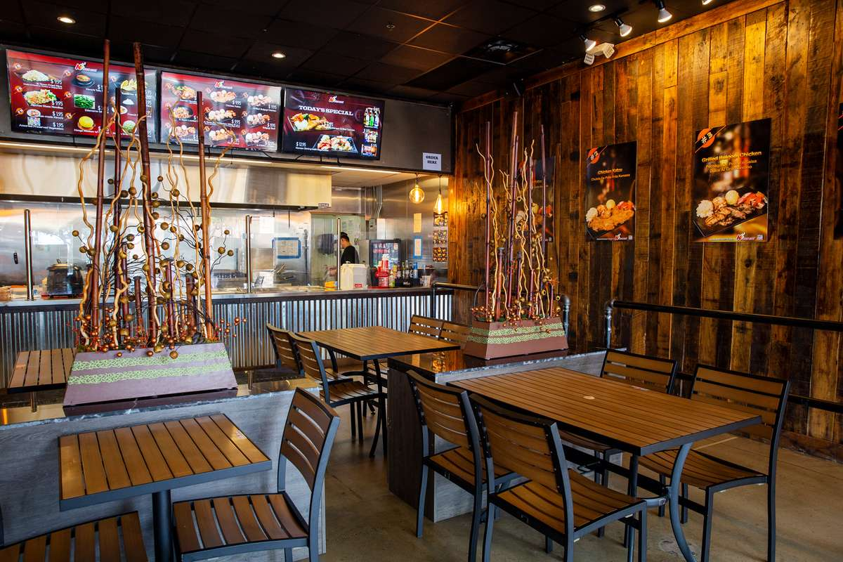 K-Town Cafe interior decor of curagated metals, dark woods, and modern black and wood dining areas