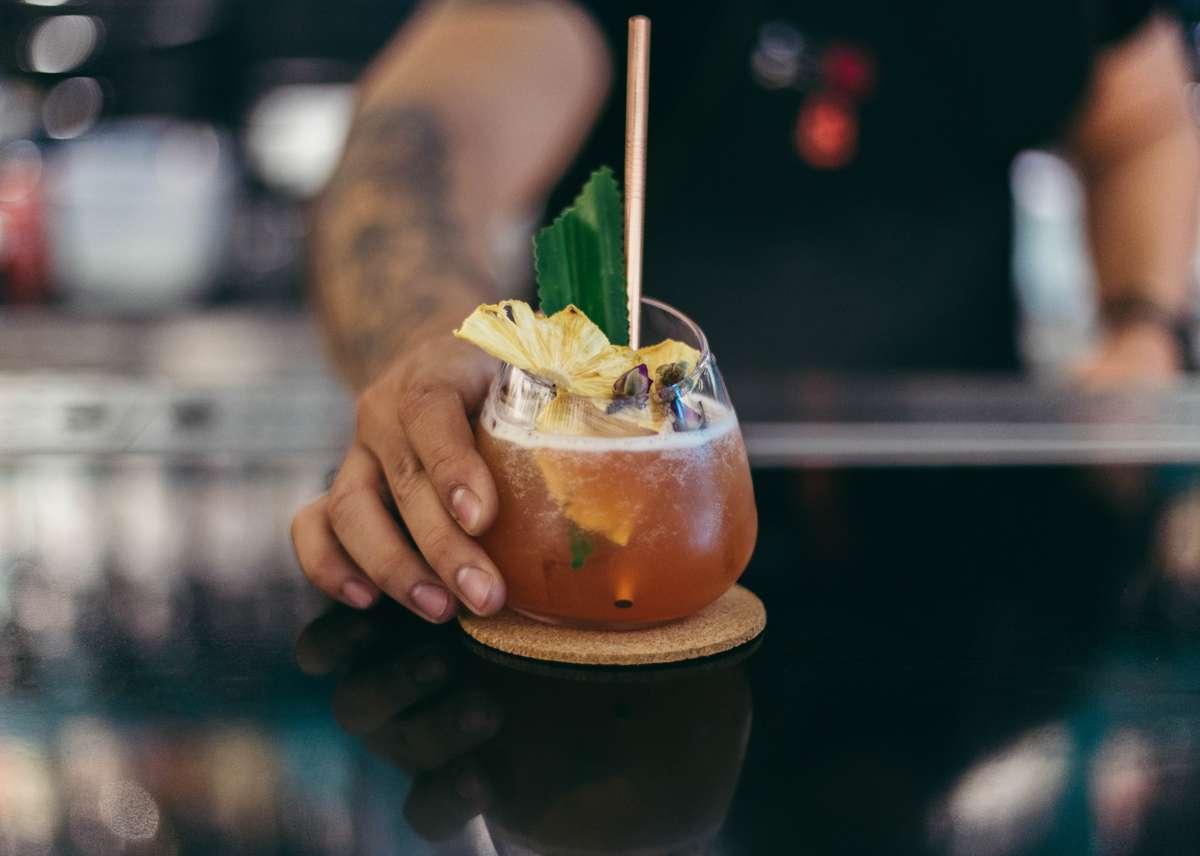 bartender serving a cocktail