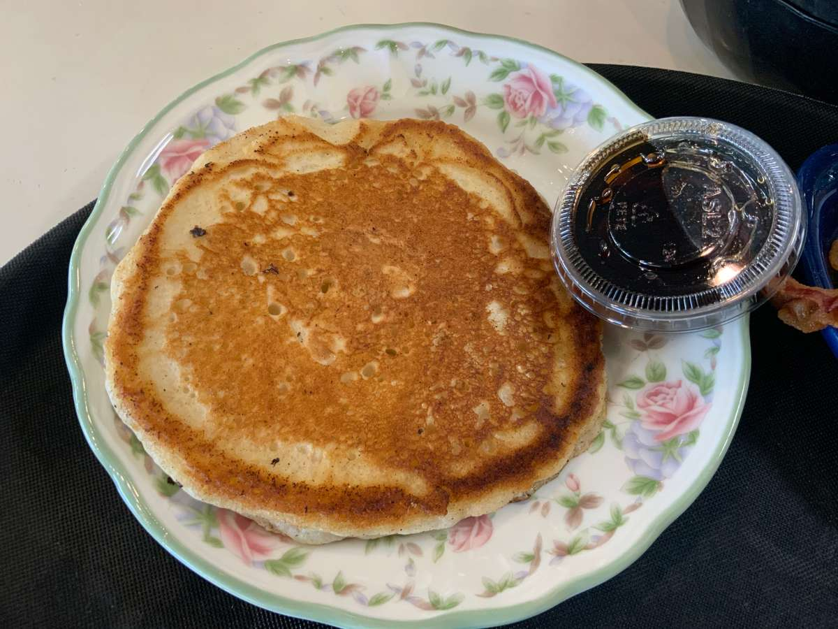 Single Pancake served with syrup and butter
