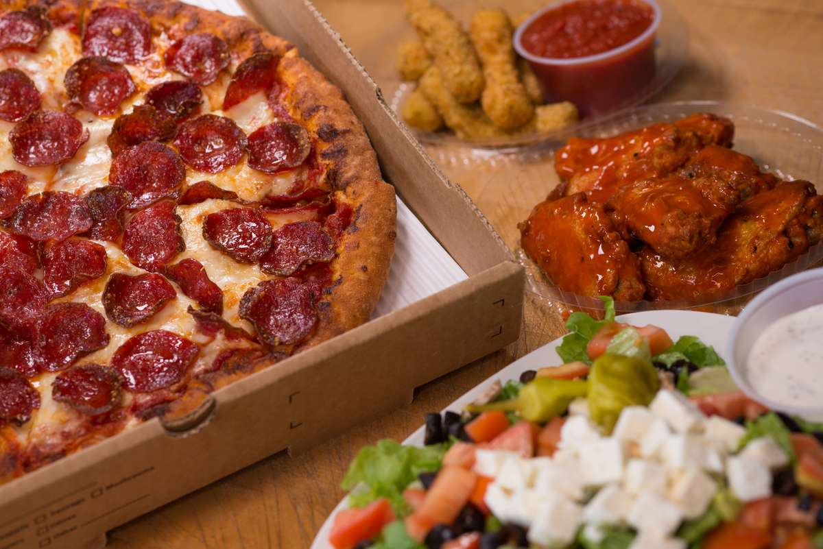 wings, salad, pepperoni pizza, and mozzarella sticks