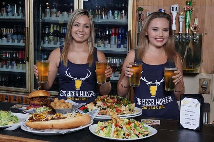 servers behind bar with food