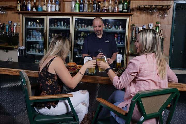 women sitting at bar