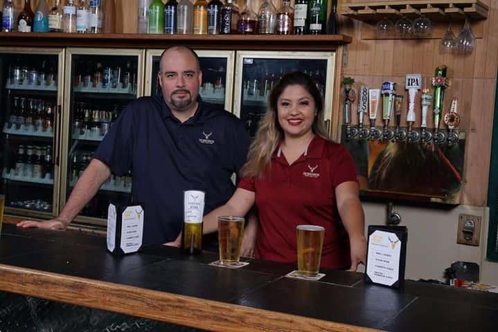 owner & employee behind bar