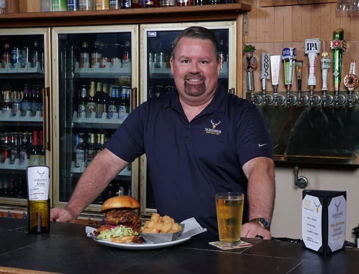 owner behind bar