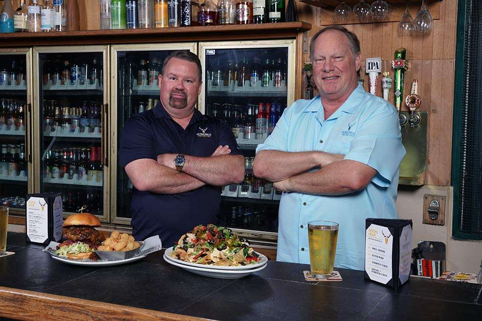 owners behind bar