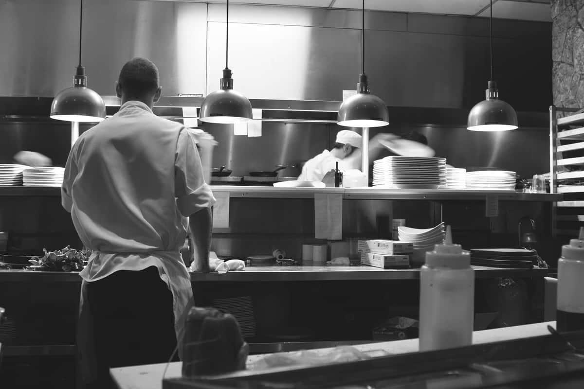 Restaurant staff cooking together