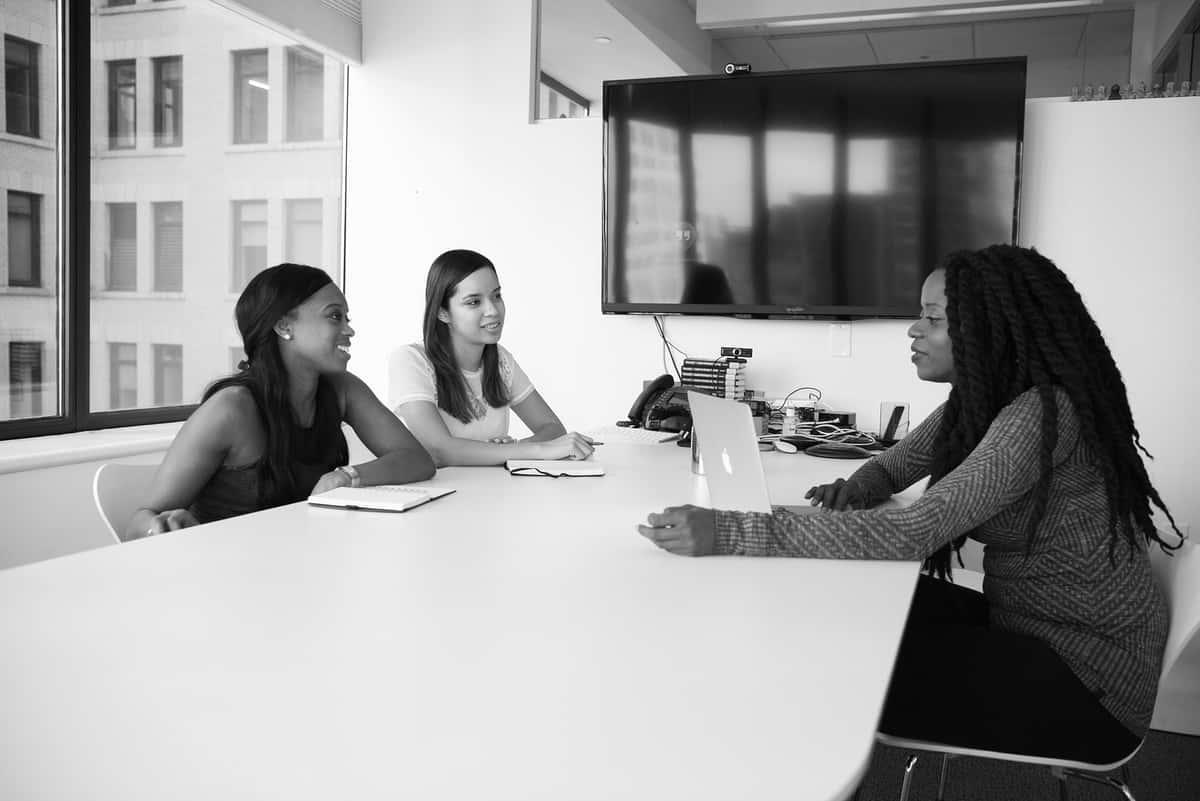 Three women having a conversation