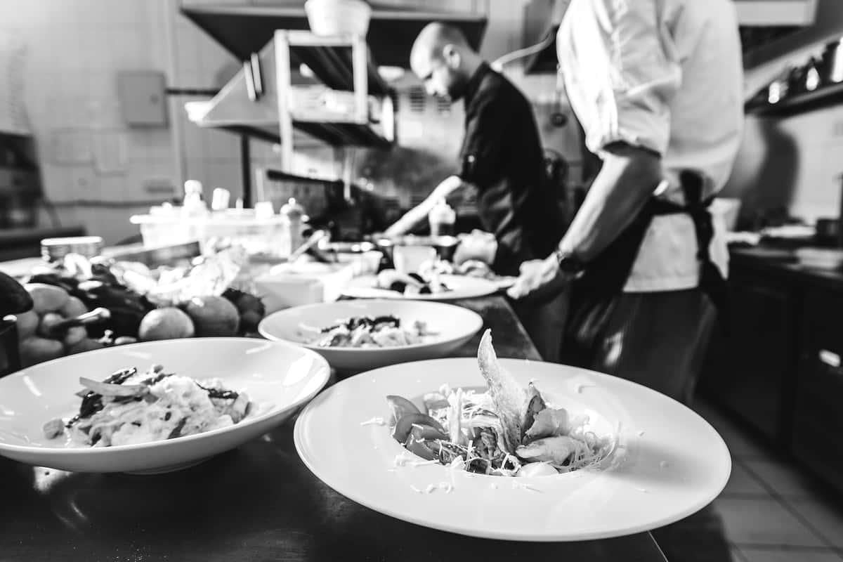 Kitchen staff plating meals