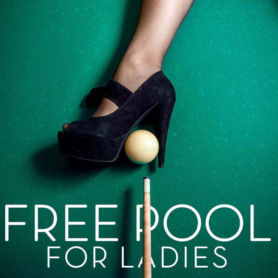 High heel shoe on top of cue ball and pool stick