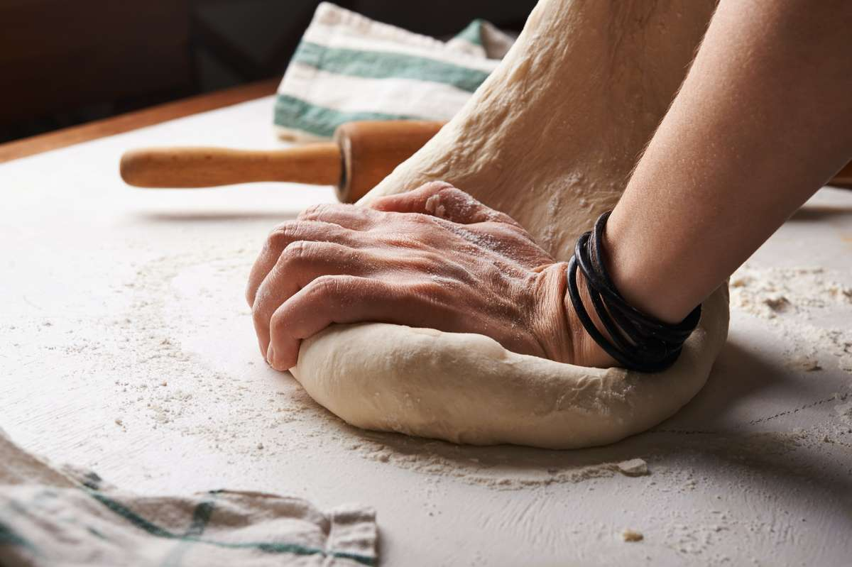 Person rolling out dough
